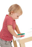 Little girl drawing with her hands Royalty Free Stock Images