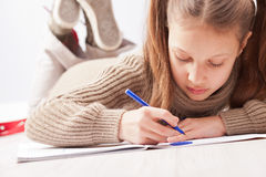 Little girl drawing on her notebook Royalty Free Stock Images