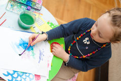 Little girl drawing at home 2 Stock Photos