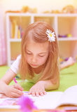 Little girl drawing at home Stock Image