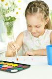 Little girl drawing at home Stock Images