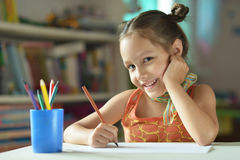 Little girl drawing at home Stock Photography
