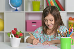 Little girl drawing at home Royalty Free Stock Images