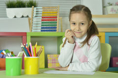 Little girl drawing at home Royalty Free Stock Photos