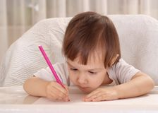 Little girl drawing at home Stock Photos