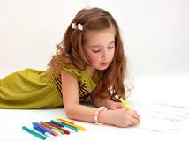 Little girl drawing on light background Stock Image