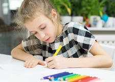 Little girl drawing. Royalty Free Stock Images