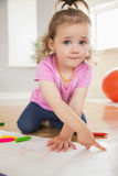 Little girl drawing in living room Stock Images