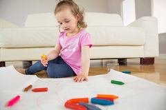 Little girl drawing in living room Stock Photos