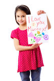 Little girl with drawing for mum Stock Image