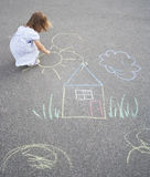 Little girl drawing outdoors Royalty Free Stock Image