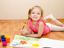 Little girl drawing with paint stock images