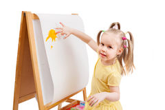Little girl is drawing by painted colors Royalty Free Stock Photos
