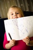 Little girl drawing with pen Stock Images