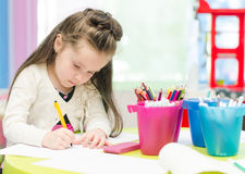 Little girl is drawing Royalty Free Stock Photo