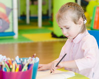 Little girl is drawing Stock Photography