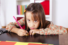 Little girl drawing with a pencil Stock Image