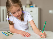 Little girl drawing. Stock Image
