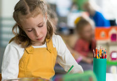 Little girl drawing. Stock Photos