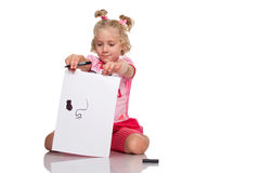 Little girl drawing with pencil Royalty Free Stock Images