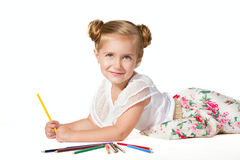Little girl drawing with pencils Stock Photo