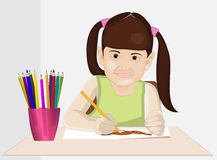 Little girl drawing with pencils Royalty Free Stock Photo