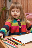 Little girl drawing with pencils at home Stock Photography