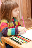 Little girl drawing with pencils at home Stock Photos
