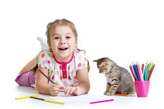 Little girl drawing with pencils and playing with cat. Kid girl drawing with pencils and playing with cat stock image