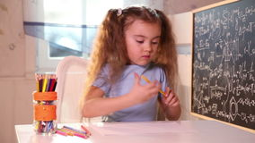 Little girl drawing with pencils stock video