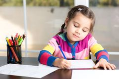 Little Girl Drawing Picture. Little Girl Is Drawing Picture stock photos