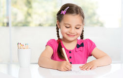 Little Girl Drawing Picture Stock Photo
