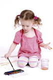 Little girl drawing a picture Stock Images