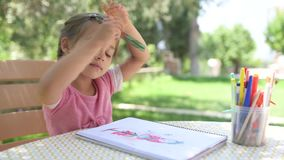 Little Girl Drawing Picture Outdoors stock footage