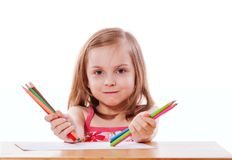 Girl drawing with pencils Stock Images