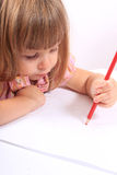 Little girl drawing pictures Stock Photos