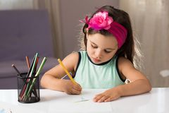 Little Girl Drawing Pictures Stock Image