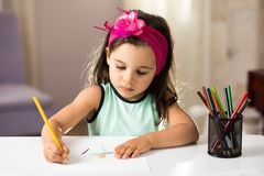 Little Girl Drawing Pictures Royalty Free Stock Photo