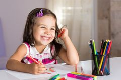 Little Girl Drawing Pictures Royalty Free Stock Photography