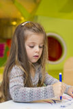 Little girl drawing at playroom Royalty Free Stock Photography