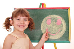 Little girl drawing smiley face Stock Photos