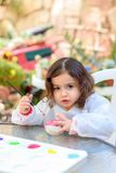 Little Girl Drawing On Stone Outdoors In Summer Sunny Day. stock photography