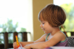Little girl drawing in a summer school Royalty Free Stock Images