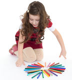 Little girl is drawing using color pencils Stock Photo