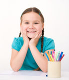 Little girl is drawing using pencils Royalty Free Stock Images