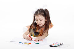 Little girl drawing. On white background royalty free stock photo