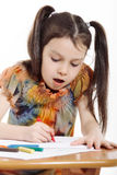 Little girl drawing. On white background royalty free stock image