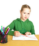 Little girl drawing on a white table Stock Photography