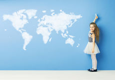 Little girl drawing a world map Royalty Free Stock Image