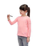 Little girl drawing or writing with marker Royalty Free Stock Photography